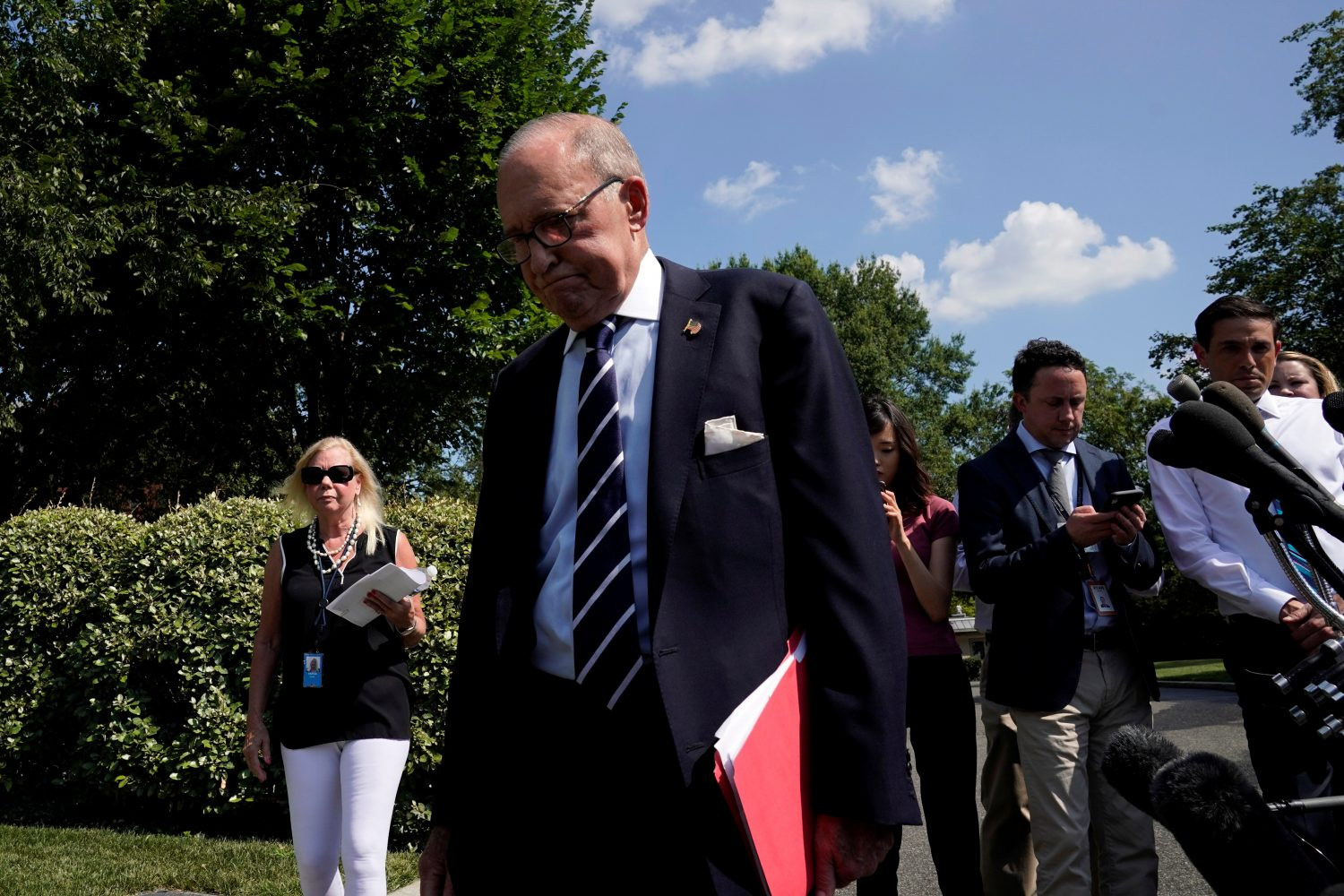 White House chief economic advisor Larry Kudlow leaves after speaking with reporters on the driveway outside the West Wing of the White House in Washington, U.S. July 26, 2019. REUTERS/Yuri Gripas