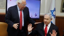 Israeli Prime Minister Benjamin Netanyahu and U.S. Ambassador to Israel David Friedman talk after watching a video of Israel's U.S.-backed Arrow-3 ballistic missile shield performing a series of live interception tests over Alaska, U.S., during a cabinet meeting in Jerusalem July 28 2019. Menahem Kahana/Pool via REUTERS