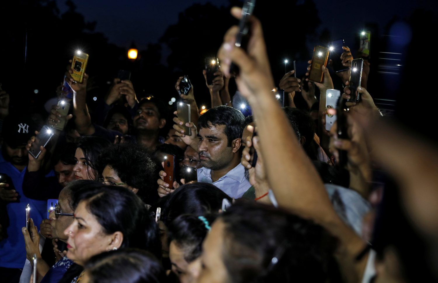 People hold their mobile phone torches as they take part in a protest demanding investigation in a highway collision in which a woman who is fighting a rape case against a legislator of the ruling Bharatiya Janata Party (BJP) was critically injured, in New Delhi, India, July 29, 2019. REUTERS/Danish Siddiqui