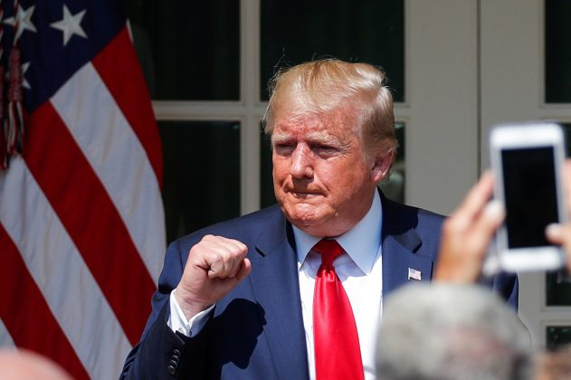 "U.S. President Donald Trump pumps his fist during a signing ceremony for the ""Permanent Authorization of the September 11th Victim Compensation Fund Act"" in the Rose Garden of the White House in Washington, U.S., July 29, 2019. REUTERS/Carlos Barria"