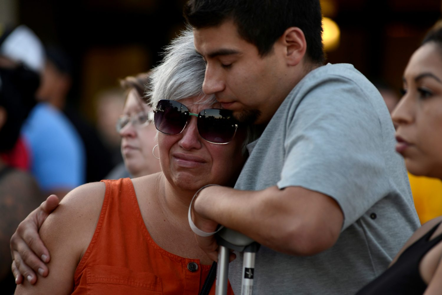 Justin Bates, a survivor of the Gilroy Garlic Festival mass shooting, and his mother, Lisa Barth, attend a vigil outside of Gilroy City Hall, in Gilroy, California, U.S. July 29, 2019. REUTERS/Kate Munsch