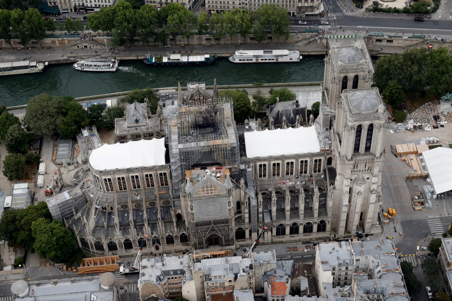 FILE PHOTO: A view shows the damaged roof of Notre-Dame de Paris during restoration work, three months after a fire that devastated the cathedral in Paris, France, July 14, 2019. REUTERS/Philippe Wojazer/File Photo