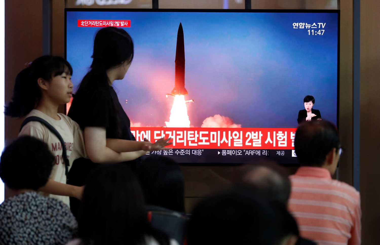 People watch a TV that shows a file picture of a North Korean missile for a news report on North Korea firing short-range ballistic missiles, in Seoul, South Korea, July 31, 2019. REUTERS/Kim Hong-Ji