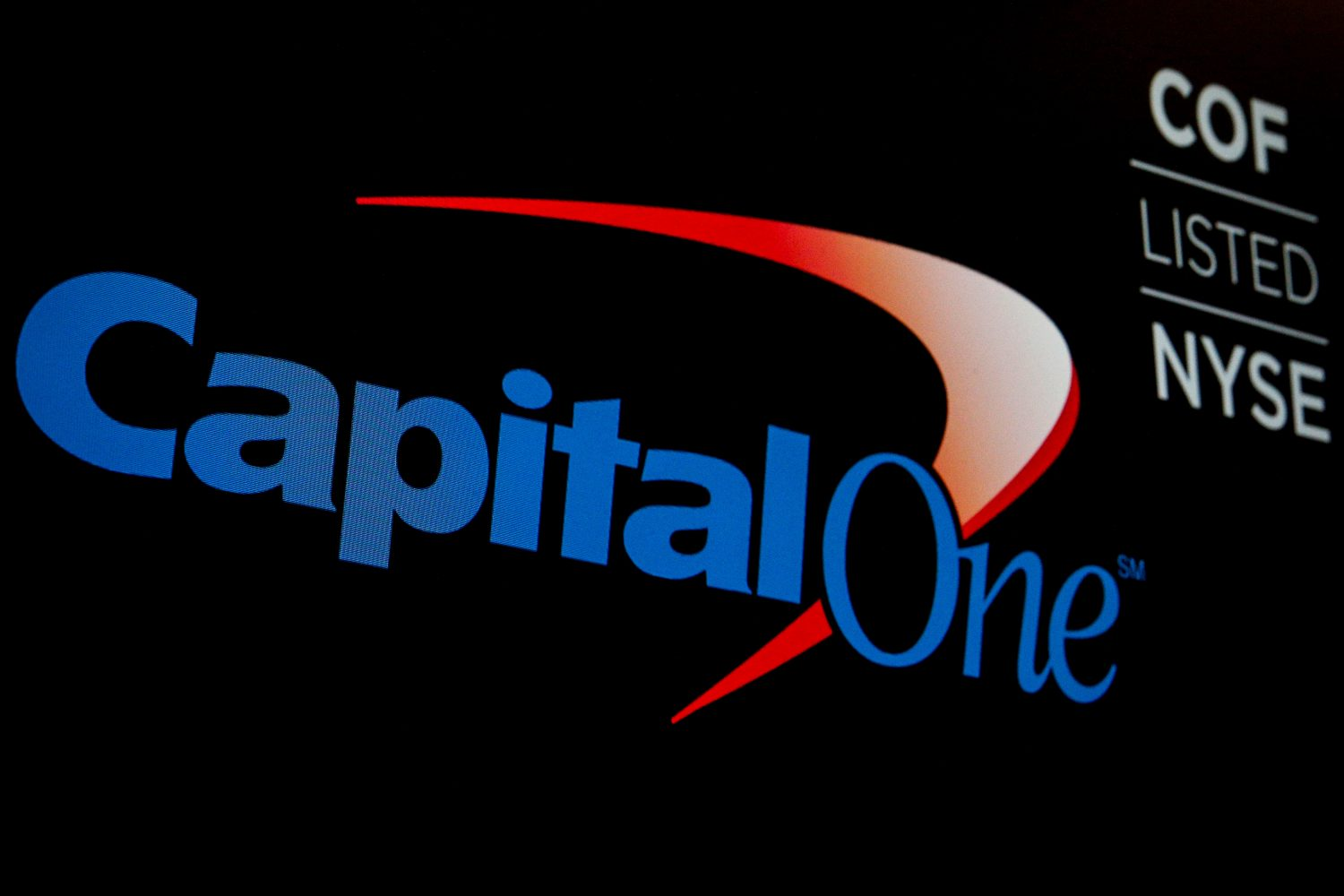 FILE PHOTO: The logo and ticker for Capital One are displayed on a screen on the floor of the New York Stock Exchange (NYSE) in New York, U.S., May 21, 2018. REUTERS/Brendan McDermid/File Photo