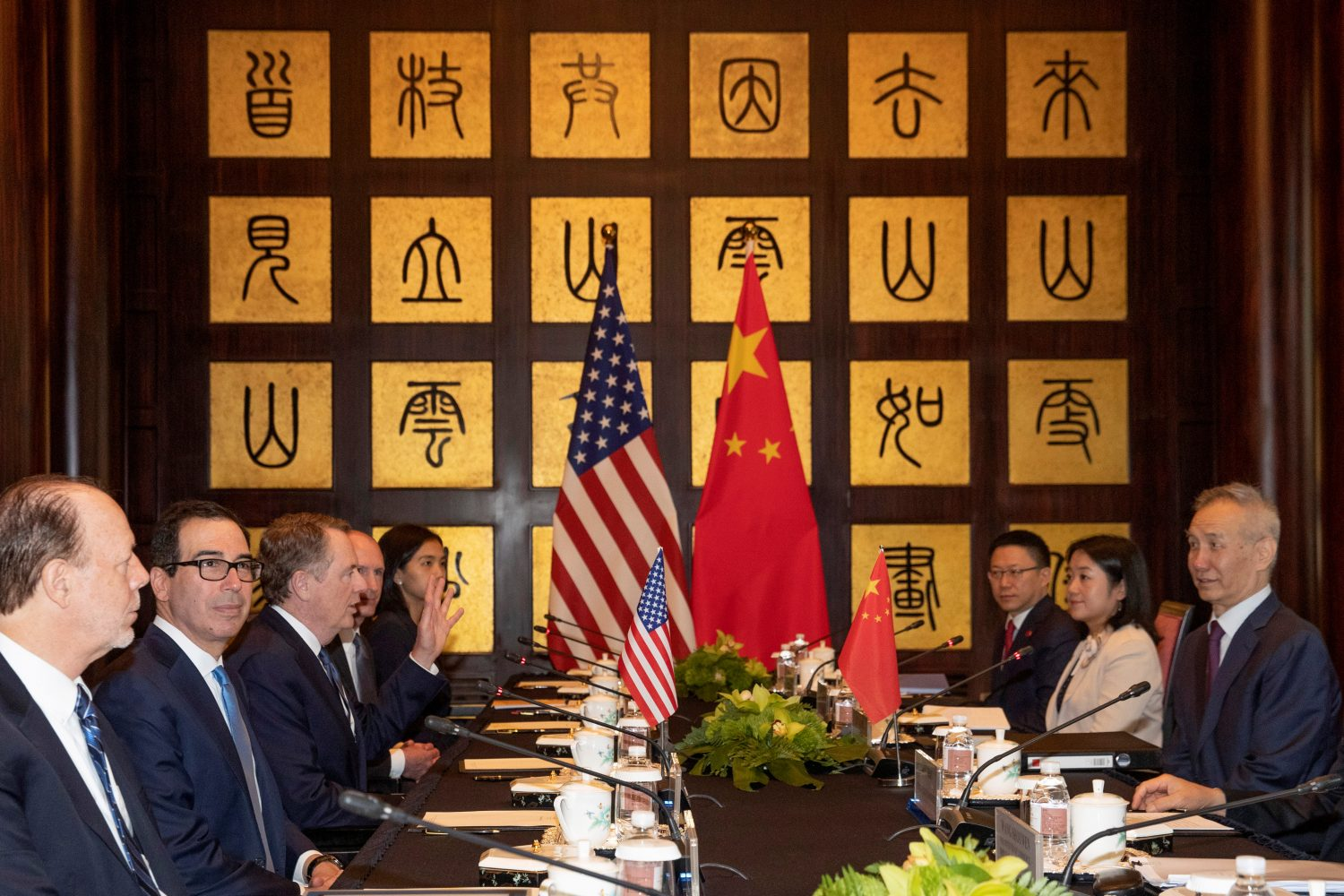 Chinese Vice Premier Liu He, at right, looks over as United States Trade Representative Robert Lighthizer, third from left gestures near Treasury Secretary Steve Mnuchin, second from left before the start of talks at the Xijiao Conference Center in Shanghai, China July 31, 2019. Ng Han Guan/Pool via REUTERS
