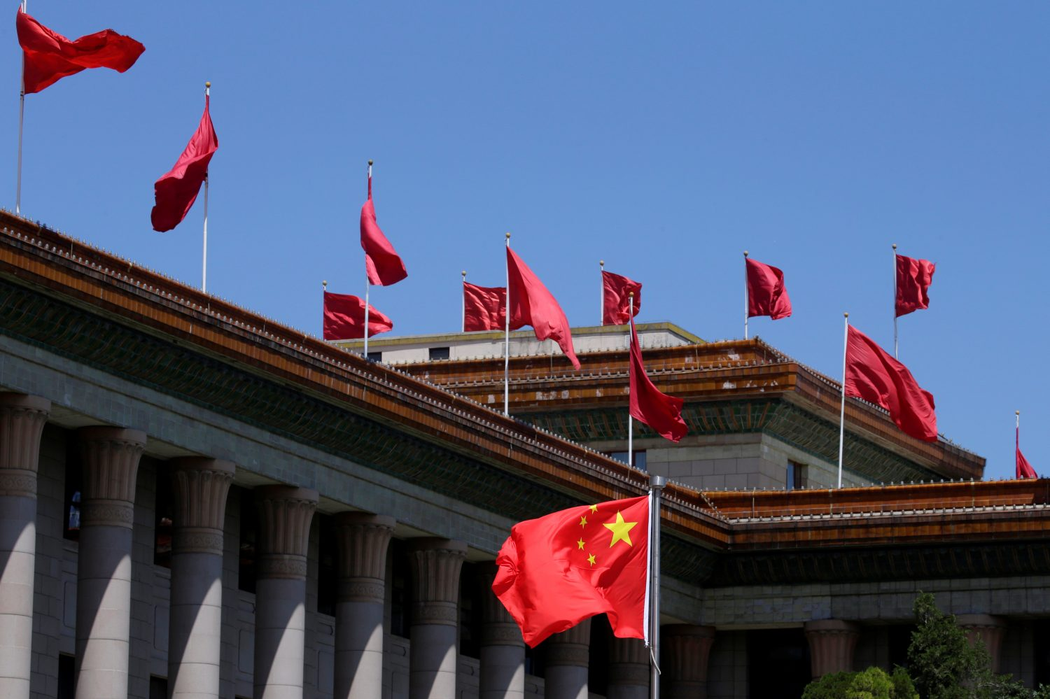 A Chinese flag flutters in front of the Great Hall of the People in Beijing, China, May 27, 2019. REUTERS/Jason Lee