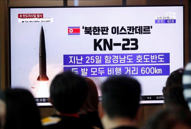 People watch a TV broadcast of a news report on North Korea firing short-range ballistic missiles, in Seoul, South Korea, July 31, 2019. REUTERS/Kim Hong-Ji