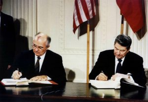 FILE PHOTO: U.S. President Ronald Reagan (R) and Soviet President Mikhail Gorbachev sign the Intermediate-Range Nuclear Forces (INF) treaty in the White House December 8 1987. REUTERS//File Photo
