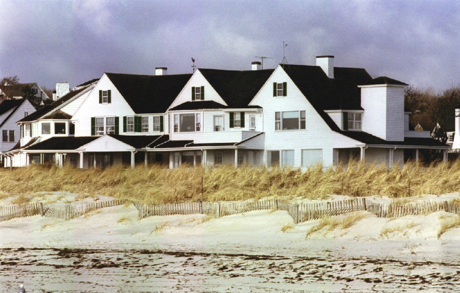 FILE PHOTO: One of three houses in the Kennedy family compound is seen in Hyannis Port January 23, 1995. REUTERS/Jim Bourg/File Photo