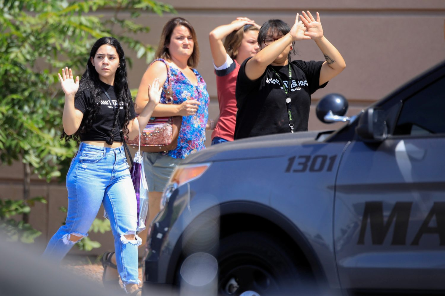 Shoppers exit with their hands up after a mass shooting at a Walmart in El Paso, Texas, U.S. August 3, 2019. REUTERS/Jorge Salgado