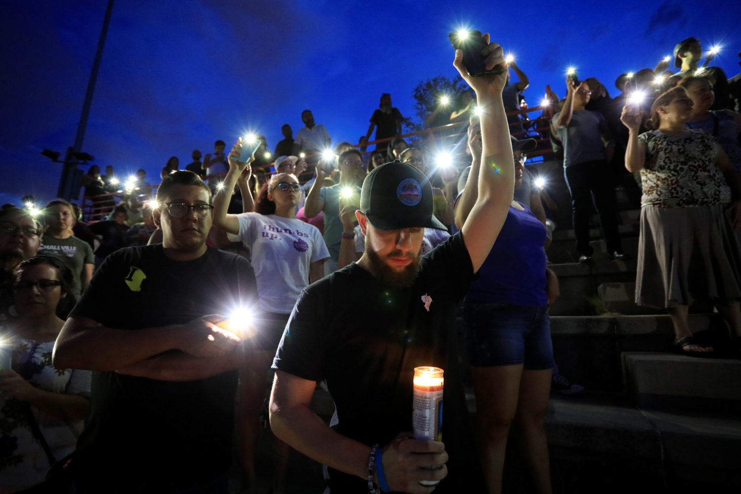 Francisco Castaneda joins mourners taking part in a vigil at El Paso High School after a mass shooting at a Walmart store in El Paso, Texas, U.S. August 3, 2019. REUTERS/Jorge Salgado NO RESALES. NO ARCHIVES.