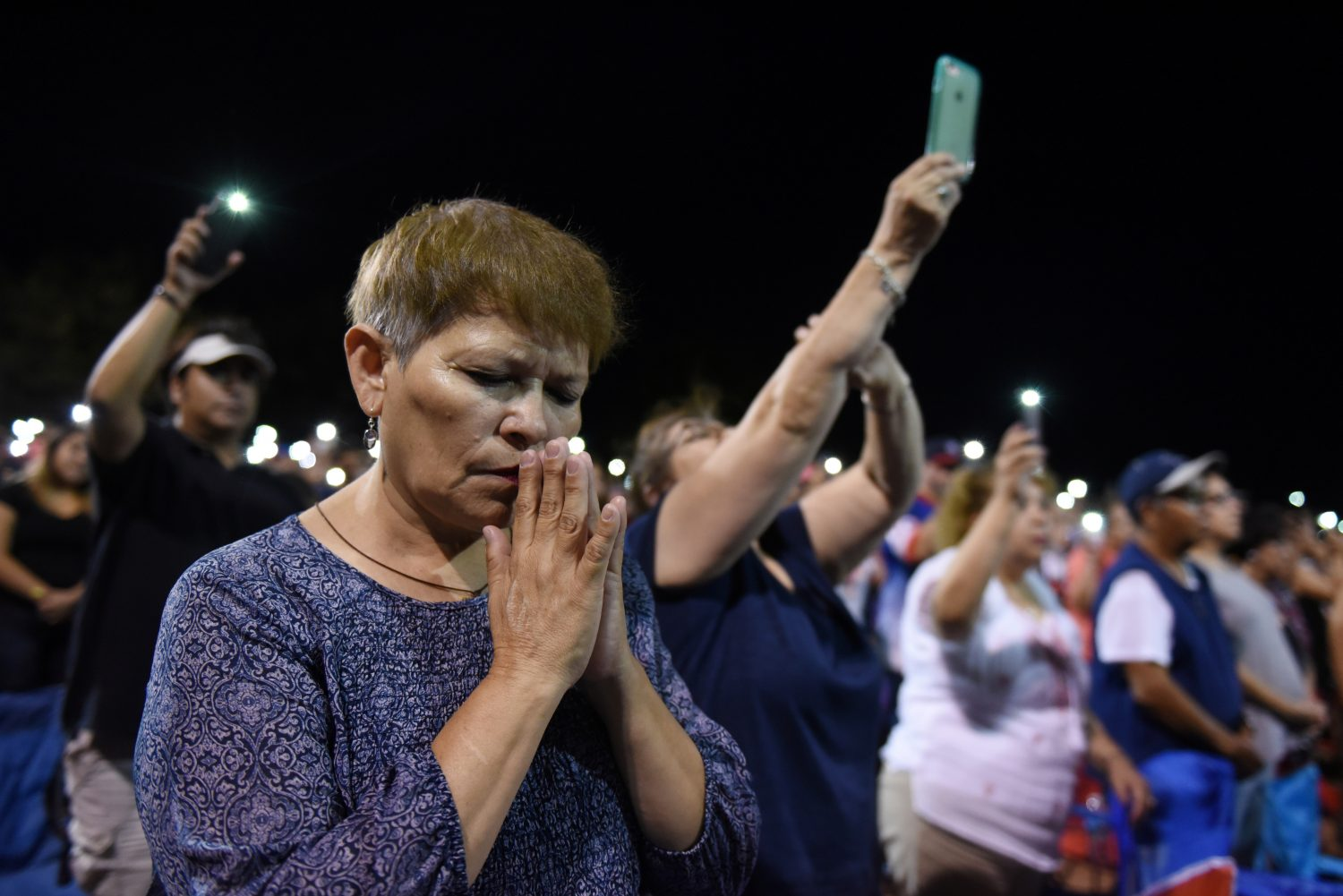 People pray during a vigil a day after a mass shooting at a Walmart store in El Paso, Texas, U.S. August 4, 2019. REUTERS/Callaghan O'Hare