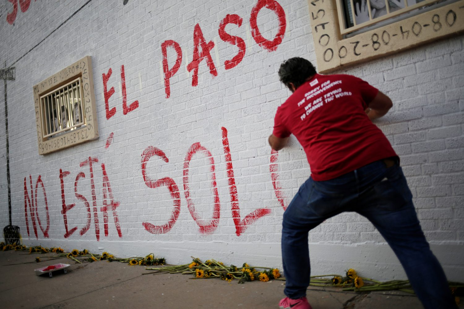 "A man takes part in a rally against hate a day after a mass shooting at a Walmart store, in El Paso, Texas, U.S. August 4, 2019. Graffiti reads ""El Paso Is Not Alone"" REUTERS/Jose Luis Gonzalez"
