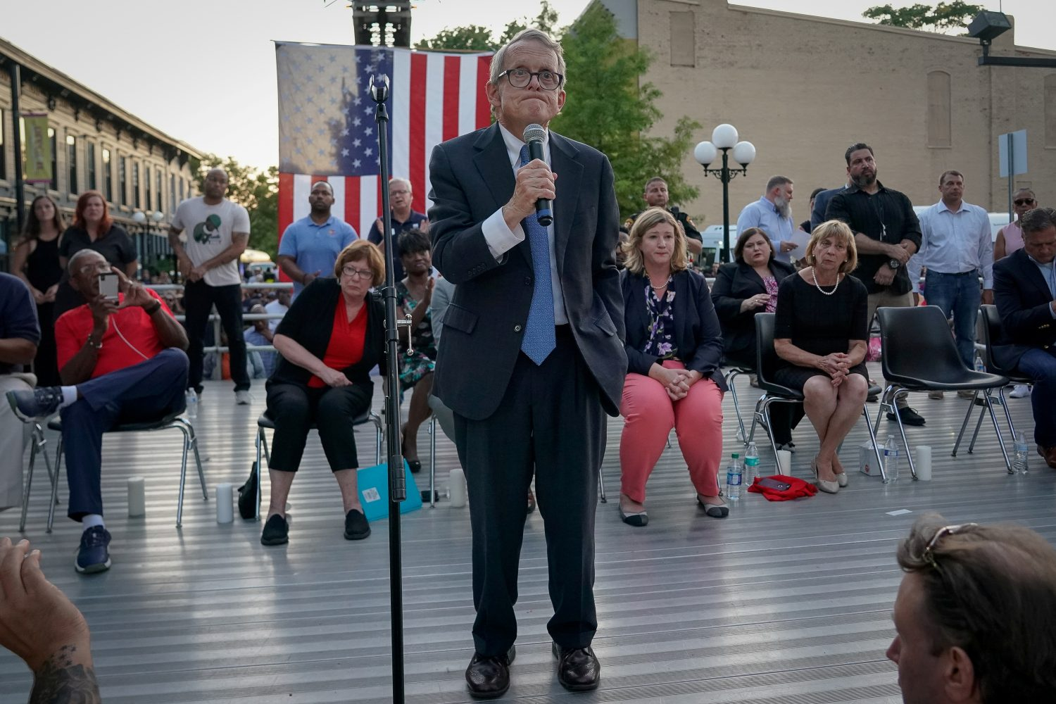 "Ohio Governor Mike DeWine reacts as vigil attendees shout ""Do Something"" while he was speaking at a vigil at the scene after a mass shooting in Dayton, Ohio, U.S. August 4, 2019. REUTERS/Bryan Woolston"