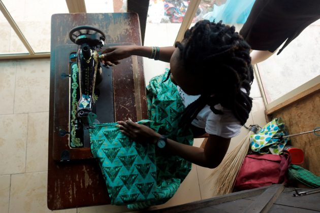 A woman, who says she was a victim of sexual exploitation and calls herself Claudia Osadolor to protect her identity, works as a tailor after training with the support of Nigerian charity Pathfinders Justice Initiative in Benin City, Nigeria July 20, 2019. Picture taken July 20, 2019. REUTERS/Nneka Chile
