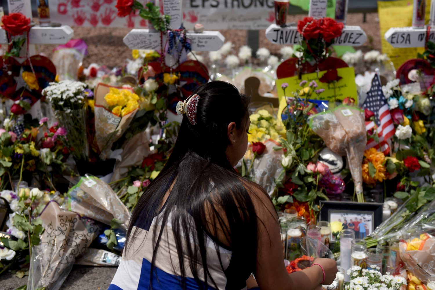 A woman kneels at a memorial three days after a mass shooting at a Walmart store in El Paso, Texas, U.S. August 6, 2019. REUTERS/Callaghan O'Hare