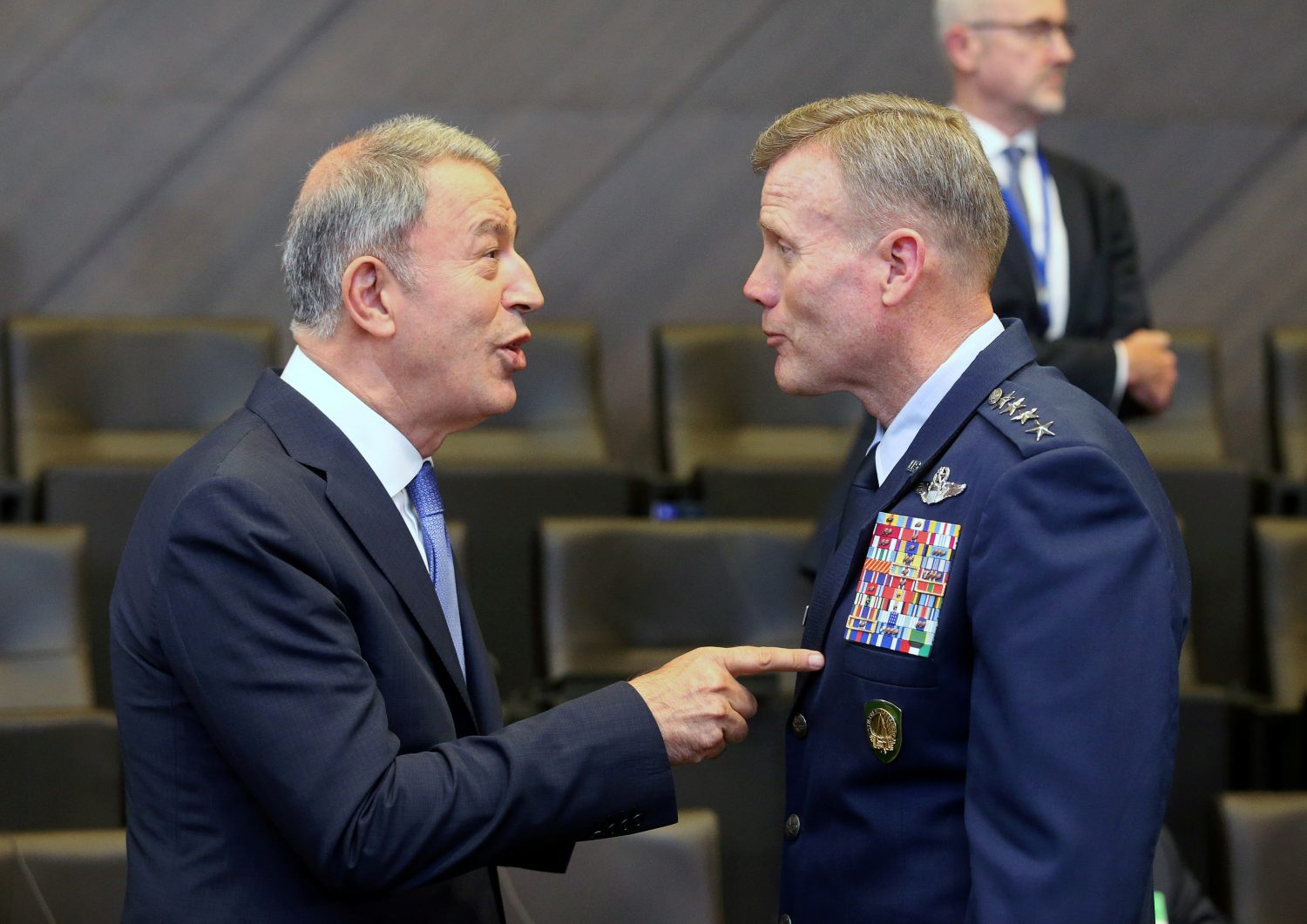 FILE PHOTO: Turkish Defence Minister Hulusi Akar (L) and the Supreme Allied Commander Europe, U.S. Air Force General Tod Wolters, speak at a NATO meeting in Brussels, Belgium, June 26, 2019. REUTERS/Francois Walschaerts/File Photo