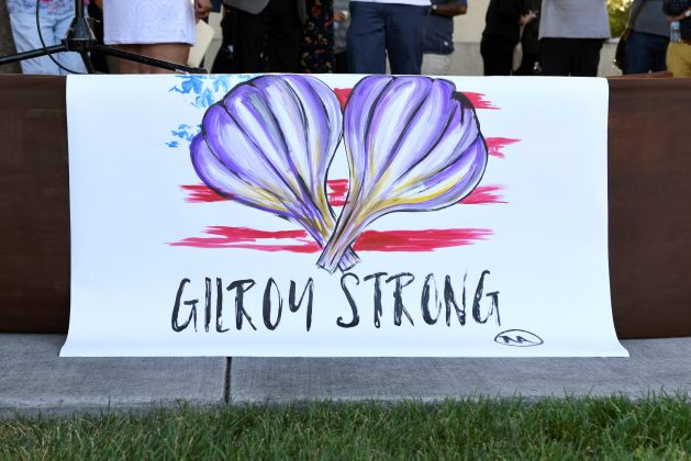 "FILE PHOTO: A painting by Gilroy resident Ignacio ""Nacho"" Moya on the stage at a vigil for those who died and were injured at the mass shooting at the Gilroy Garlic Festival a day earlier, in Gilroy, California, U.S. July 29, 2019. REUTERS/Kate Munsch"
