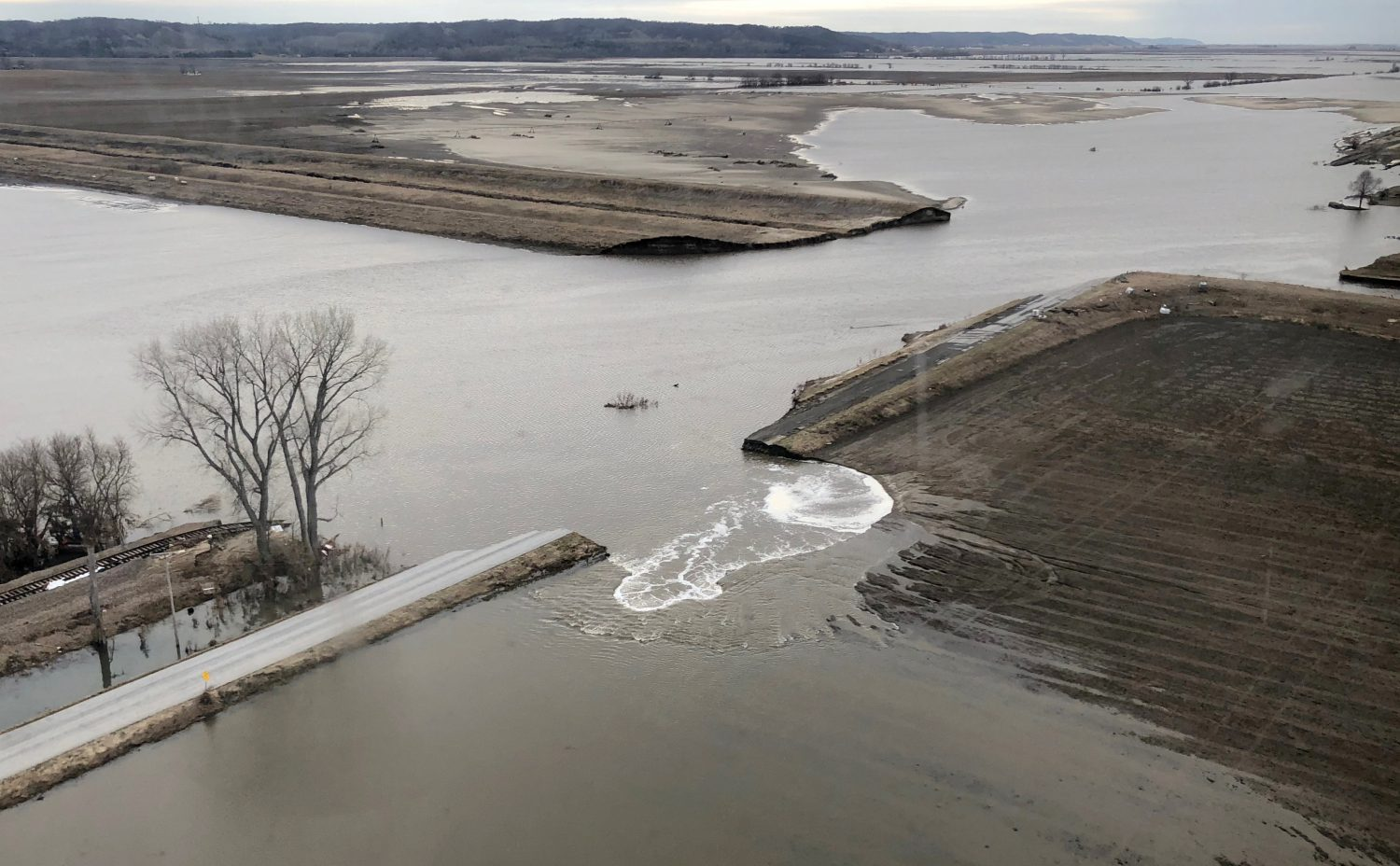 FILE PHOTO: A levee breach is shown in this aerial photo, from flood damage near Bartlett, Iowa, U.S., March 29, 2019. REUTERS/Tom Polansek/File Photo