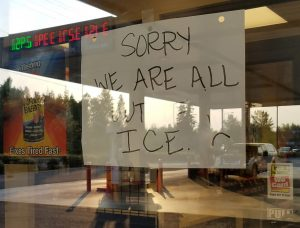 "A sign reading ""Sorry we are all out of ice"" is posted on the door of a gas station in Anchorage, Alaska, U.S., July 7, 2019. REUTERS/Yereth Rosen"