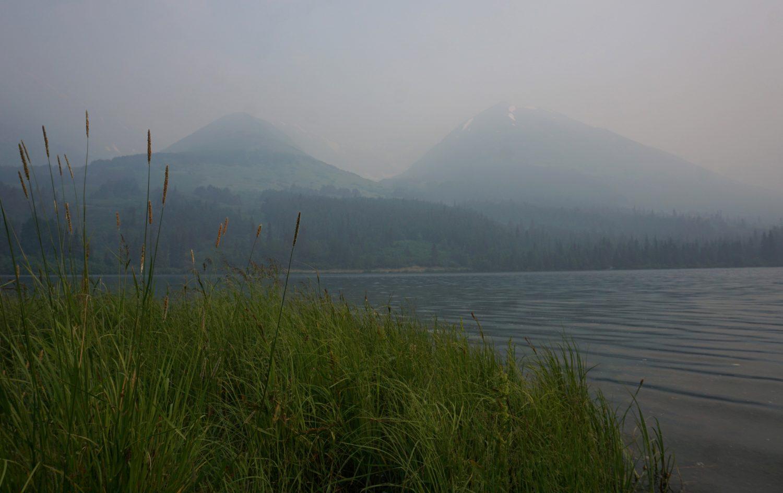 Smoke shrouds Summit Lake with a thick blanket of smoke from the Swan Lake Fire on Kenai Peninsula, Alaska, U.S., July 5, 2019. REUTERS/Yereth Rosen