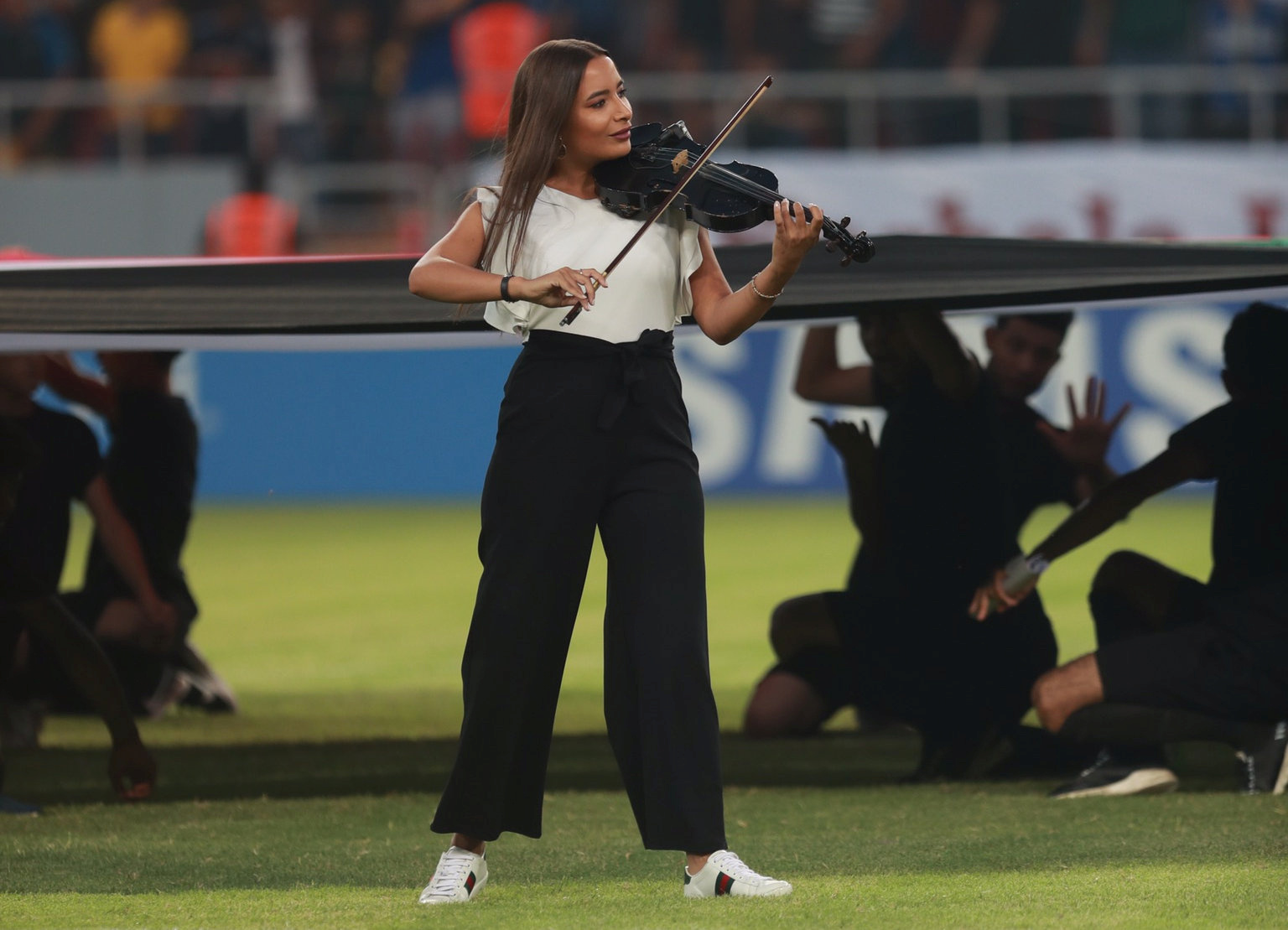 Joelle Saade, violinist, plays Iraq's national anthem during an opening ceremony of the West Asia Football Federation Championship at Kerbala Stadium in the holy city of Kerbala, Iraq July 30, 2019. Picture taken July 30, 2019. REUTERS/Stringer