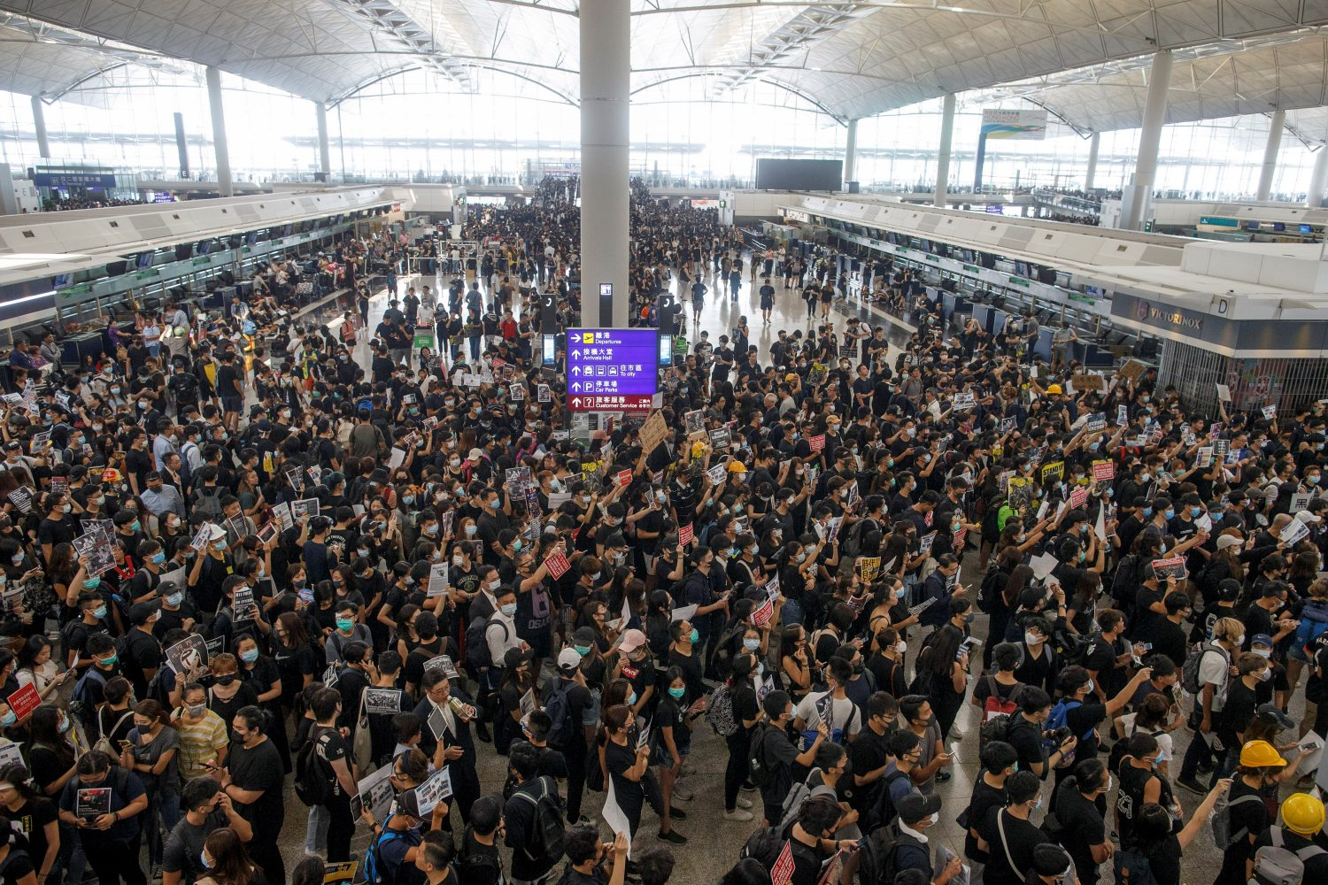 Anti-extradition bill protesters rally at the departure hall of Hong Kong airport in Hong Kong, China August 12, 2019. REUTERS/Thomas Peter