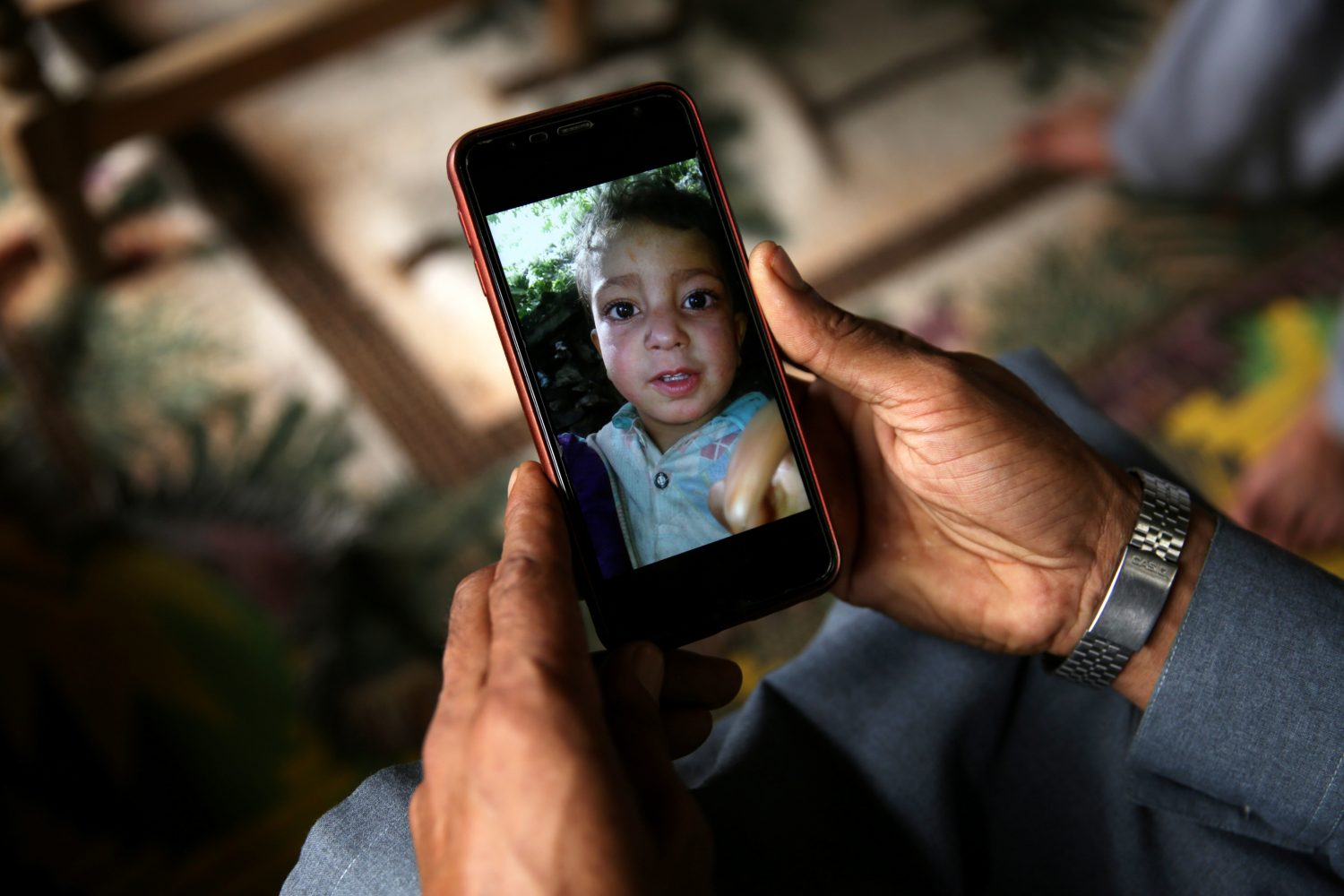 A relative displays the picture of 4-year-old Mohammad Ayan Ali, who, according to his family, was killed after he found a device that looked like a toy and exploded in his hands at home in the village of Jabri, in Neelum Valley, in Pakistan-administrated Kashmir. Pakistan's military says the device was an unexploded cluster bomb.. REUTERS/Saiyna Bashir
