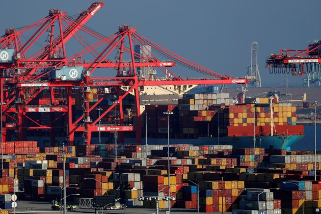 FILE PHOTO: Ships and shipping containers are pictured at the port of Long Beach in Long Beach, California, U.S., January 30, 2019. REUTERS/Mike Blake
