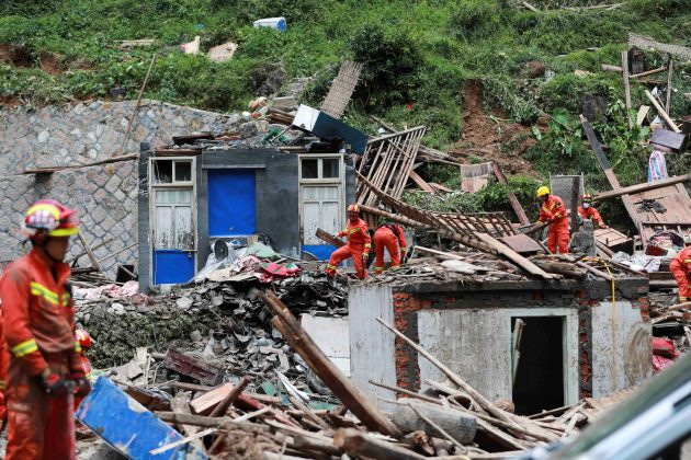 Firefighters search for survivors in collapsed houses damaged by a landslide after Typhoon Lekima hit Shanzao village in Yongjia county, Wenzhou, Zhejiang province, China August 11, 2019. REUTERS/Stringer
