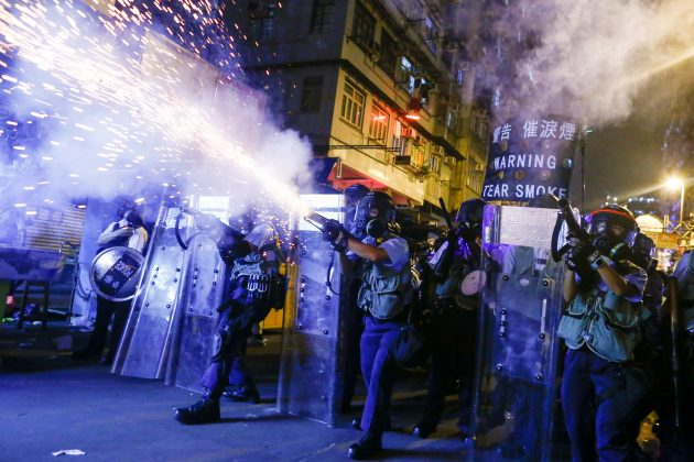 Police fire tear gas at anti-extradition bill protesters during clashes in Sham Shui Po in Hong Kong, China, August 14, 2019. REUTERS/Thomas Peter