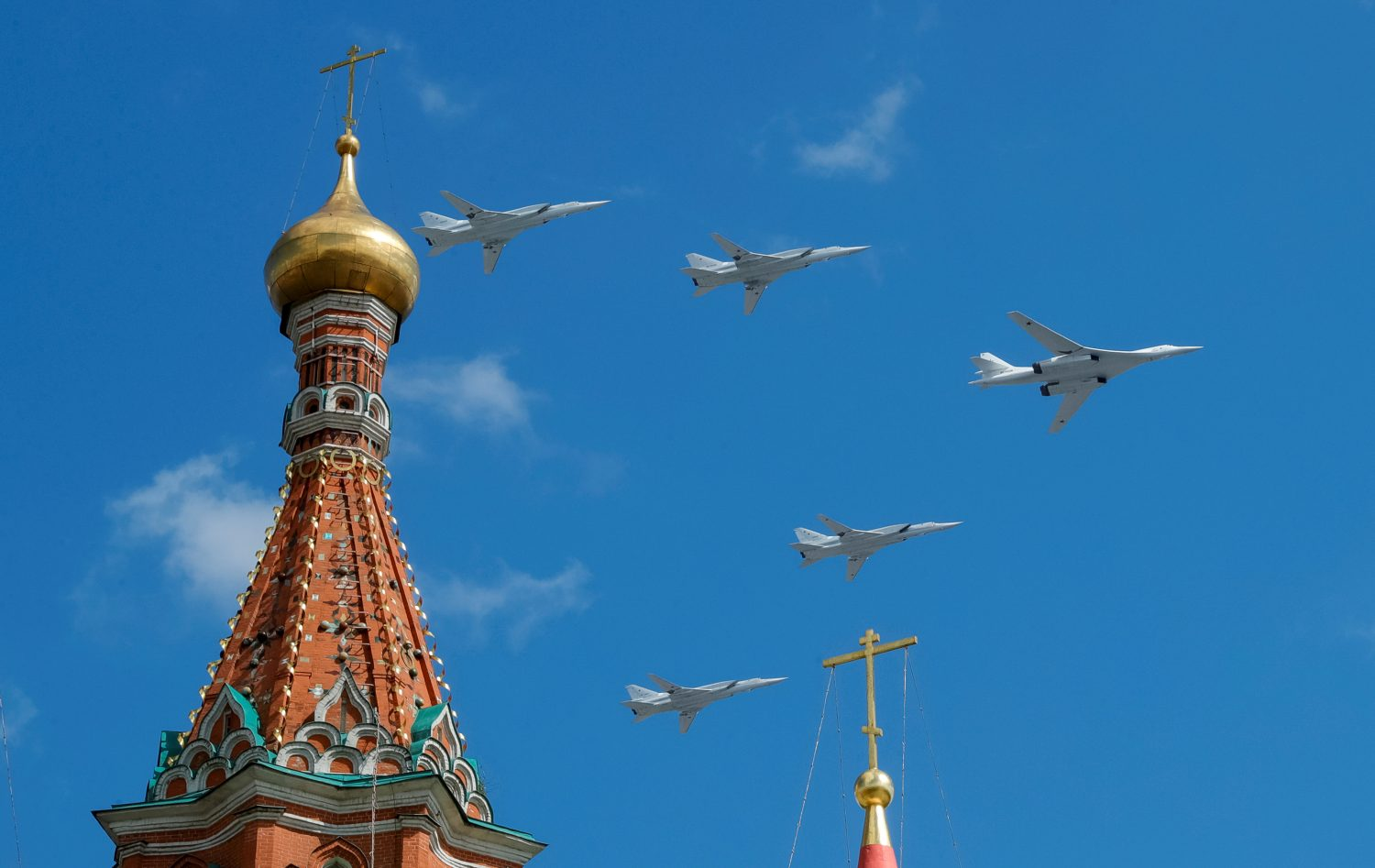 FILE PHOTO: Russian army Tupolev Tu-160 (R) and Tupolev Tu-22M3 fly in formation over St. Basil's Cathedral during the rehearsal for the Victory Day parade in Moscow, Russia May 4, 2019. REUTERS/Tatyana Makeyeva/File Photo