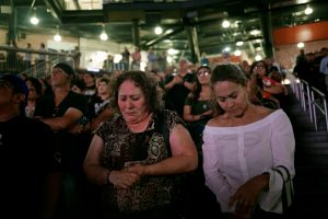 People take part in a memorial for the victims of a shooting at a Walmart store in El Paso, Texas, U.S. August 14, 2019. REUTERS/Jose Luis Gonzalez