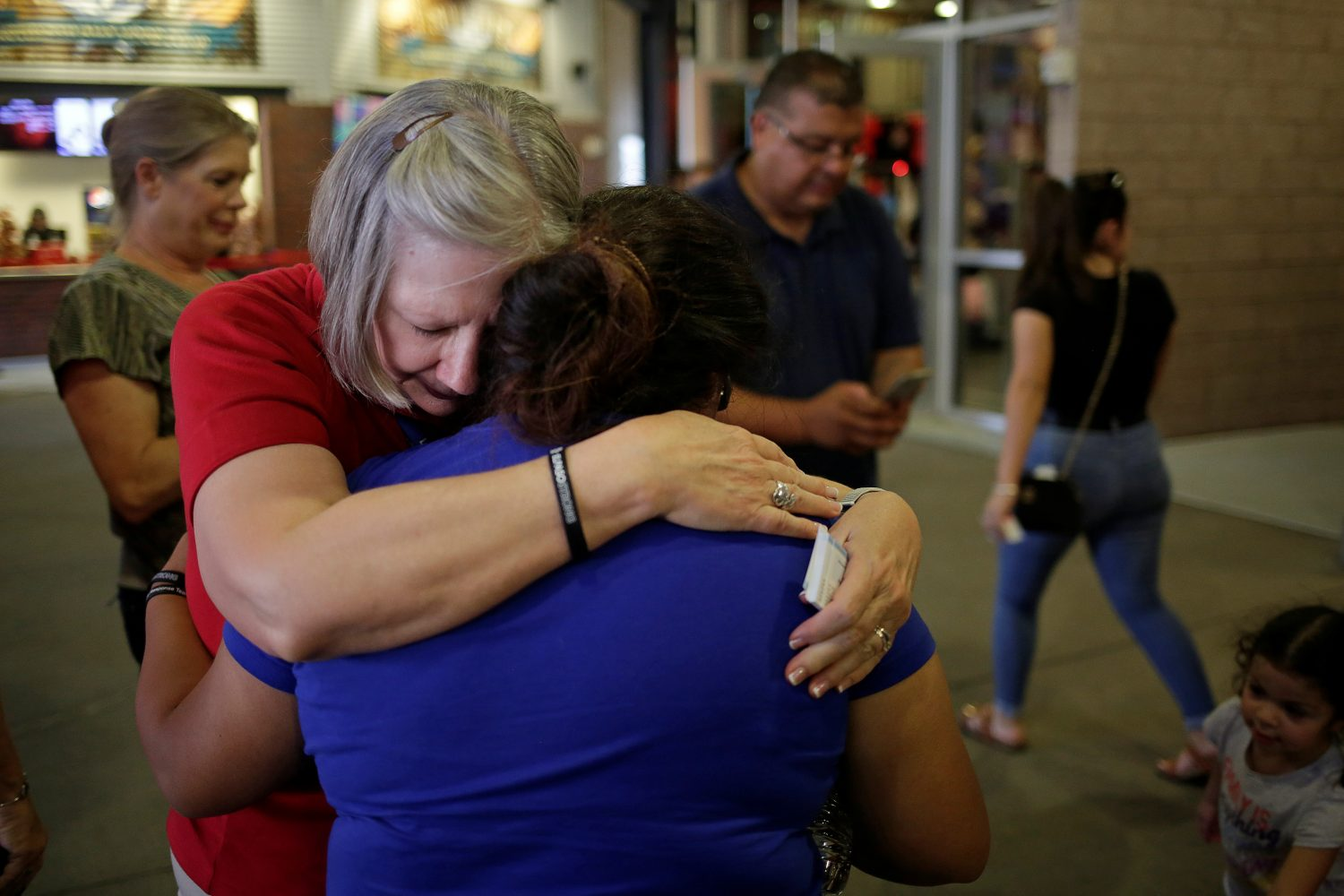 People embrace during a memorial for the victims of a shooting at a Walmart store in El Paso, Texas, U.S. August 14, 2019. REUTERS/Jose Luis Gonzalez