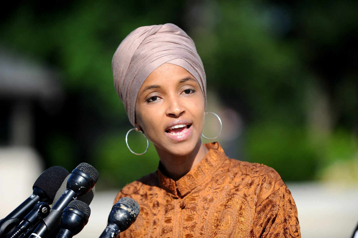 "FILE PHOTO: Rep. Ilhan Omar (D-MN) holds a news conference to discuss legislation creating ""a federal grant program to help local governments invest in waste reduction initiatives"", at the U.S. Capitol in Washington, U.S., July 25, 2019. REUTERS/Mary F. Calvert/File Photo"