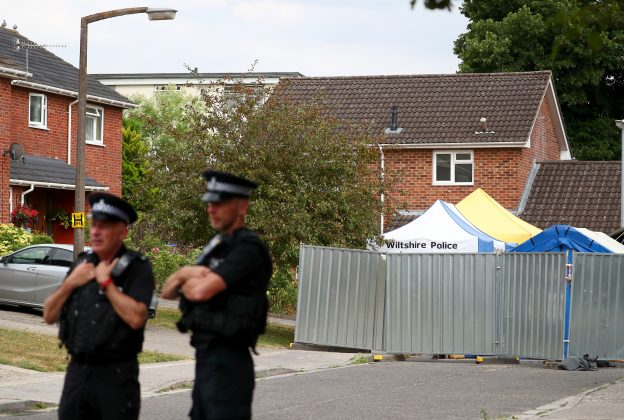 FILE PHOTO: Police officers stand on duty outside Sergei Skripal's home in Salisbury, Britain, July 19, 2018. REUTERS/Hannah McKay