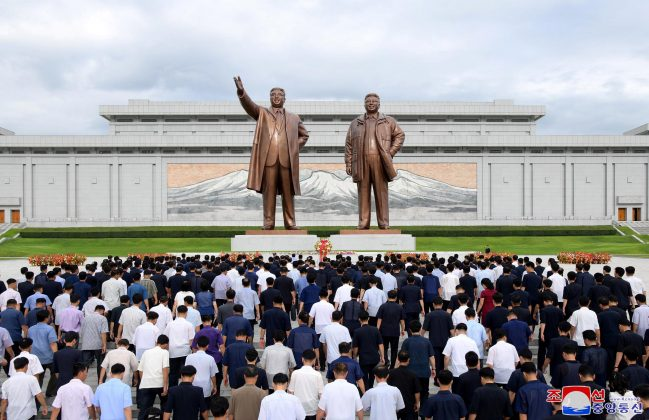 People visit the statues of former North Korean leaders Kim Il Sung and Kim Jong Il to commemorate the 74th anniversary of the end of the Japanese occupation of Korea, in this undated photo supplied by the Korean Central News Agency (KCNA) on August 16, 2019. KCNA/ via REUTERS