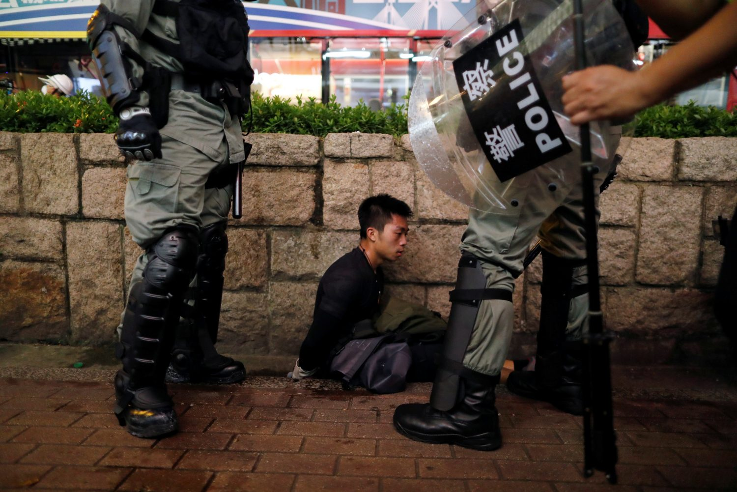 Riot police officers detain an anti-extradition bill protester during a demonstration in Tsim Sha Tsui neighbourhood in Hong Kong, China, August 11, 2019. REUTERS/Issei Kato