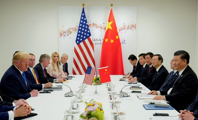 FILE PHOTO: U.S. President Donald Trump meets with China's President Xi Jinping at the start of their bilateral meeting at the G20 leaders summit in Osaka, Japan, June 29, 2019. REUTERS/Kevin Lamarque/File Photo/File Photo