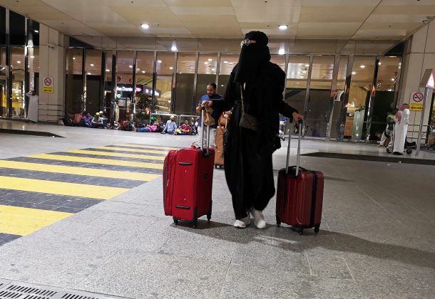 A Saudi woman walks with her luggage as she arrives at King Fahd International Airport in Dammam, Saudi Arabia, August 5, 2019. REUTERS/Hamad I Mohammed
