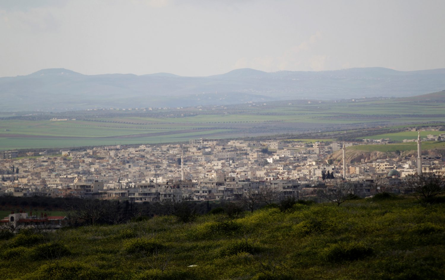 FILE PHOTO: A general view shows Khan Sheikhoun in the southern countryside of Idlib March 16, 2015. REUTERS/Khalil Ashawi/File Photo - RC12399C7770