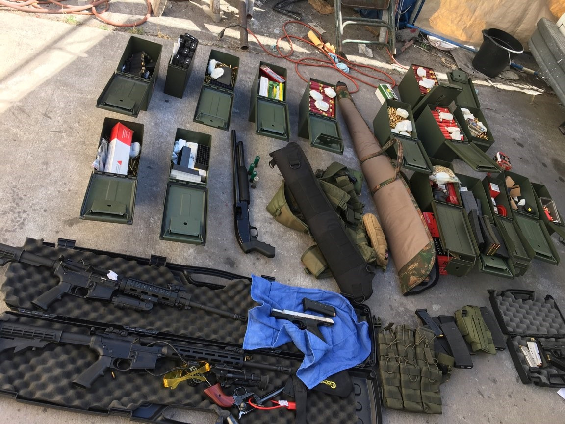 Illegal high-capacity magazines and an assault rifle along with multiple guns, ammunition are seen in this Long Beach Police Department (LBPD) photo in Long Beach, California, U.S., released on August 21, 2019. Courtesy LBPD/Handout via REUTERS
