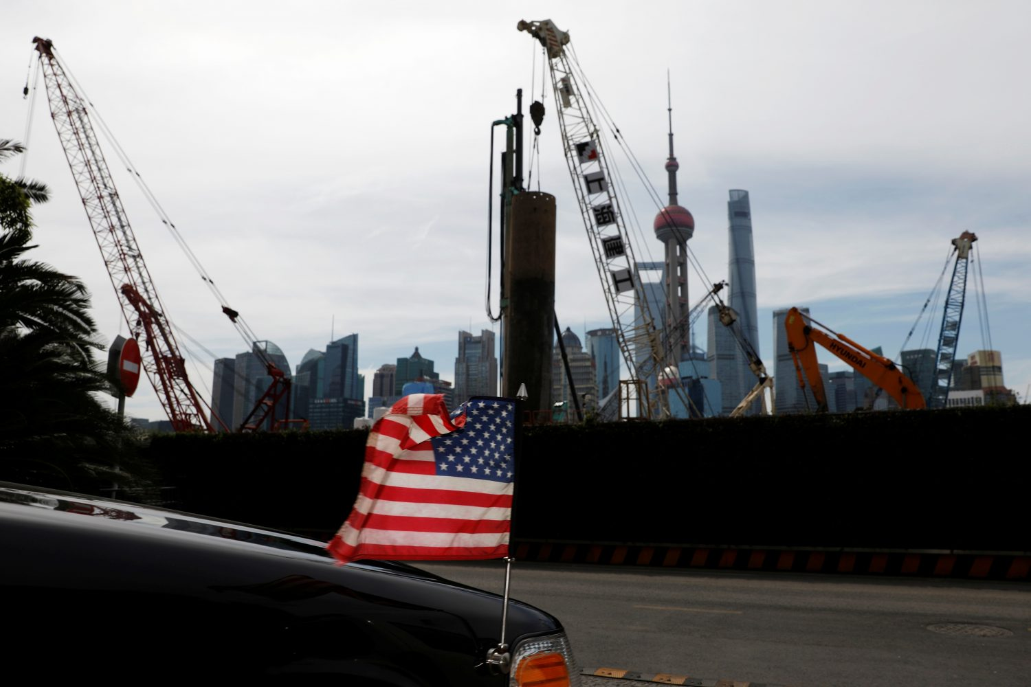 FILE PHOTO: A U.S. flag on an embassy car is seen outside a hotel near a construction site in Shanghai, China, July 31, 2019. REUTERS/Aly Song