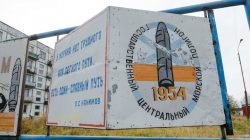 """FILE PHOTO: A view shows a board on a street of the military garrison located near the village of Nyonoksa in Arkhangelsk Region, Russia October 7, 2018. The board reads: """"State Central Naval Range"""". Picture taken October 7, 2018. REUTERS/Sergei Yakovlev"""