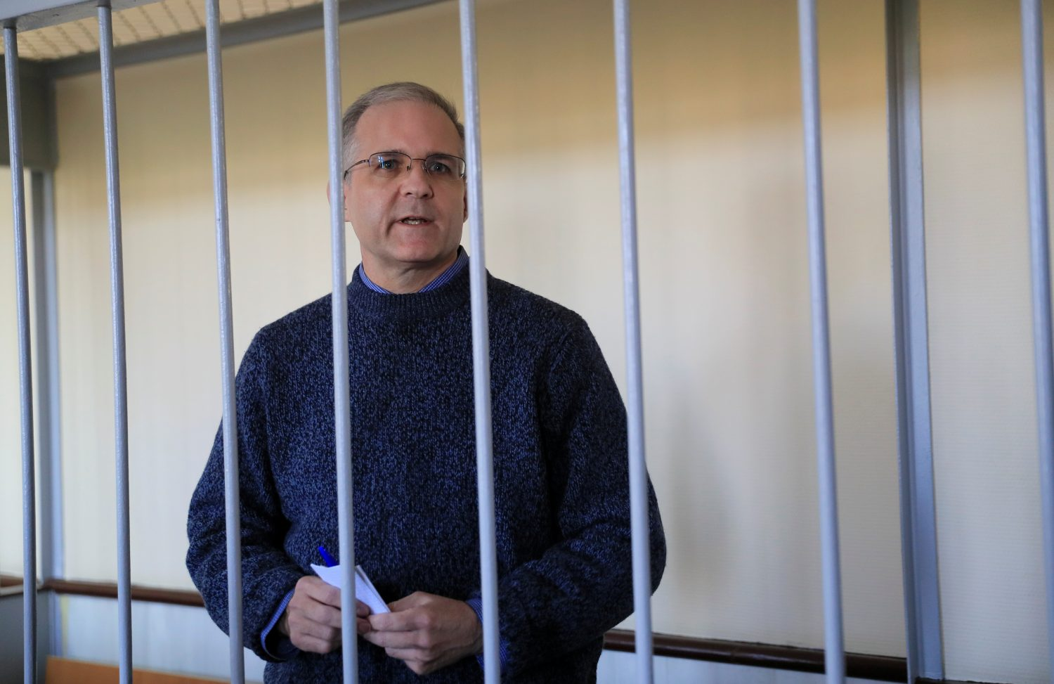 Former U.S. Marine Paul Whelan, who was detained and accused of espionage, stands inside a defendants' cage before a court hearing in Moscow, Russia August 23, 2019. REUTERS/Tatyana Makeyeva