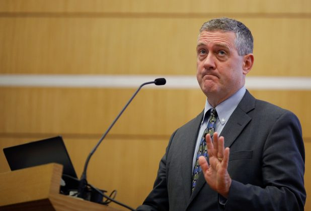 FILE PHOTO: St. Louis Federal Reserve Bank President James Bullard speaks at a public lecture in Singapore October 8, 2018. REUTERS/Edgar Su