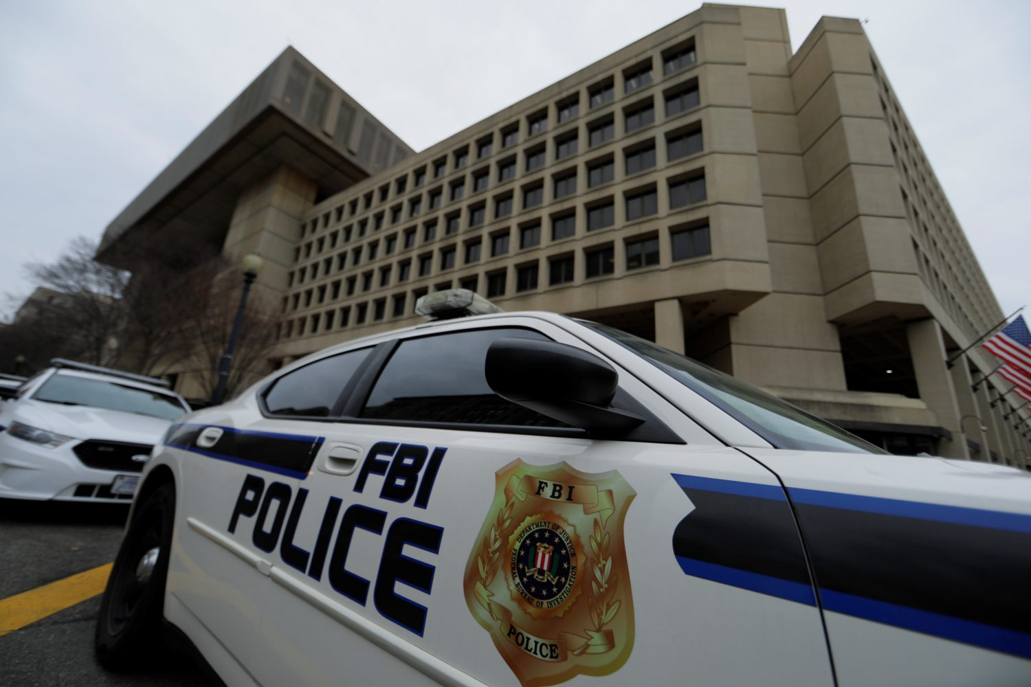 FILE PHOTO: FBI police vehicles sit parked outside of the J. Edgar Hoover Federal Bureau of Investigation Building in Washington, U.S., February 1, 2018. REUTERS/Jim Bourg