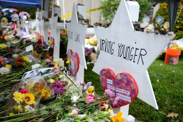 FILE PHOTO: Flowers and other items have been left as memorials outside the Tree of Life synagogue following last Saturday's shooting in Pittsburgh, Pennsylvania, U.S., November 3, 2018. REUTERS/Alan Freed