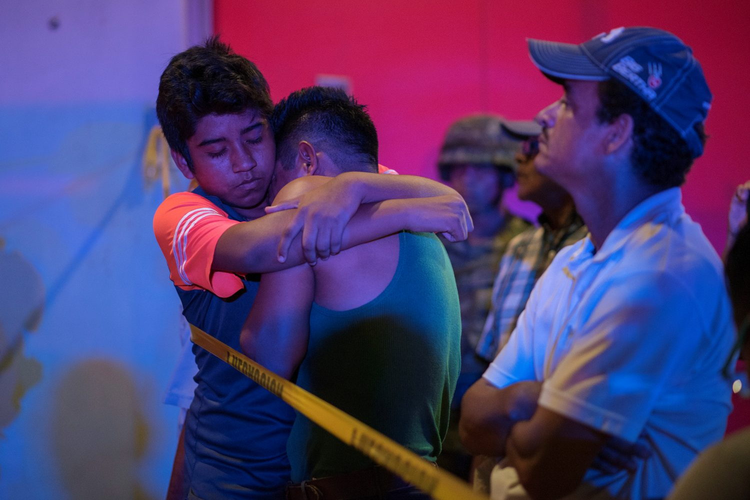 A man is comforted at a crime scene following a deadly attack at a bar by unknown assailants in Coatzacoalcos, Mexico August 28, 2019. REUTERS/Angel Hernandez