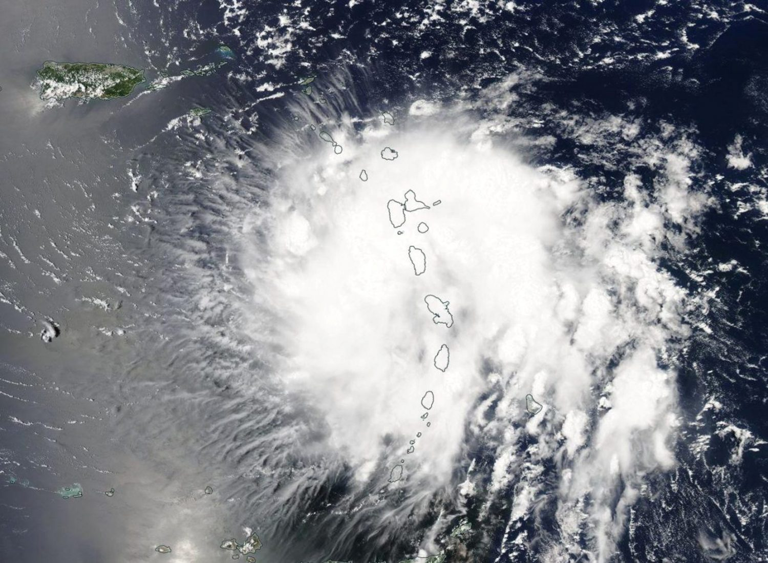 Tropical Storm Dorian is shown in this photo taken by NASA's Aqua satellite MODIS instrument as it moved over the Leeward Islands, as it continues its track into the Eastern Caribbean Sea, August 27, 2019. NASA Worldview, Earth Observing System Data and Information System (EOSDIS)/Handout via REUTERS